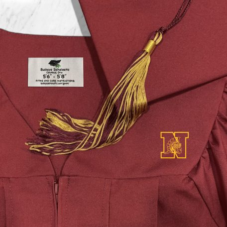 maroon cap and gown with graduation tassel