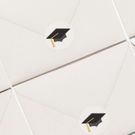 Two white envelopes with envelope seals placed on them.