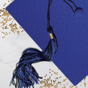 Royal blue graduation cap with blue and black tassel